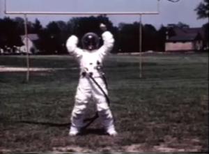 NASA EVA suit tester does toe touches on the gridiron