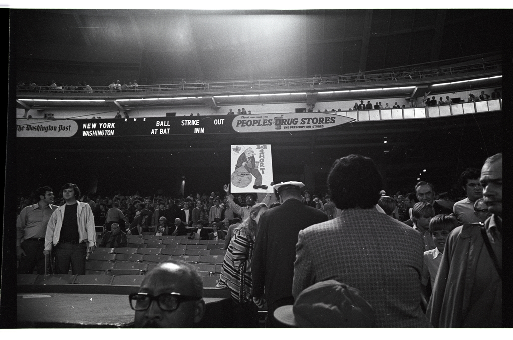 Fan with Cartoon Sign, September 30, 1971
