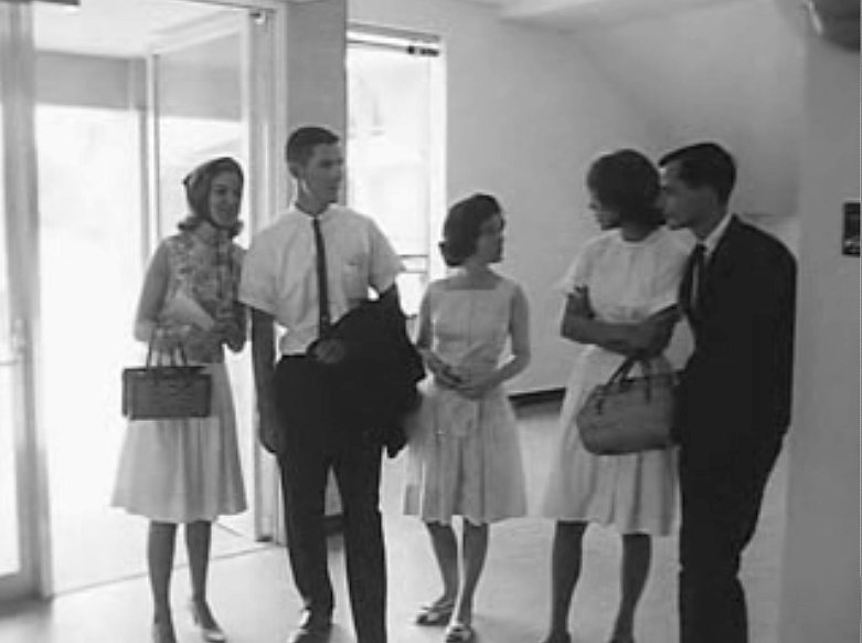 Student members of a tour group in the lobby of the North Building (now known as Finley), 1964.