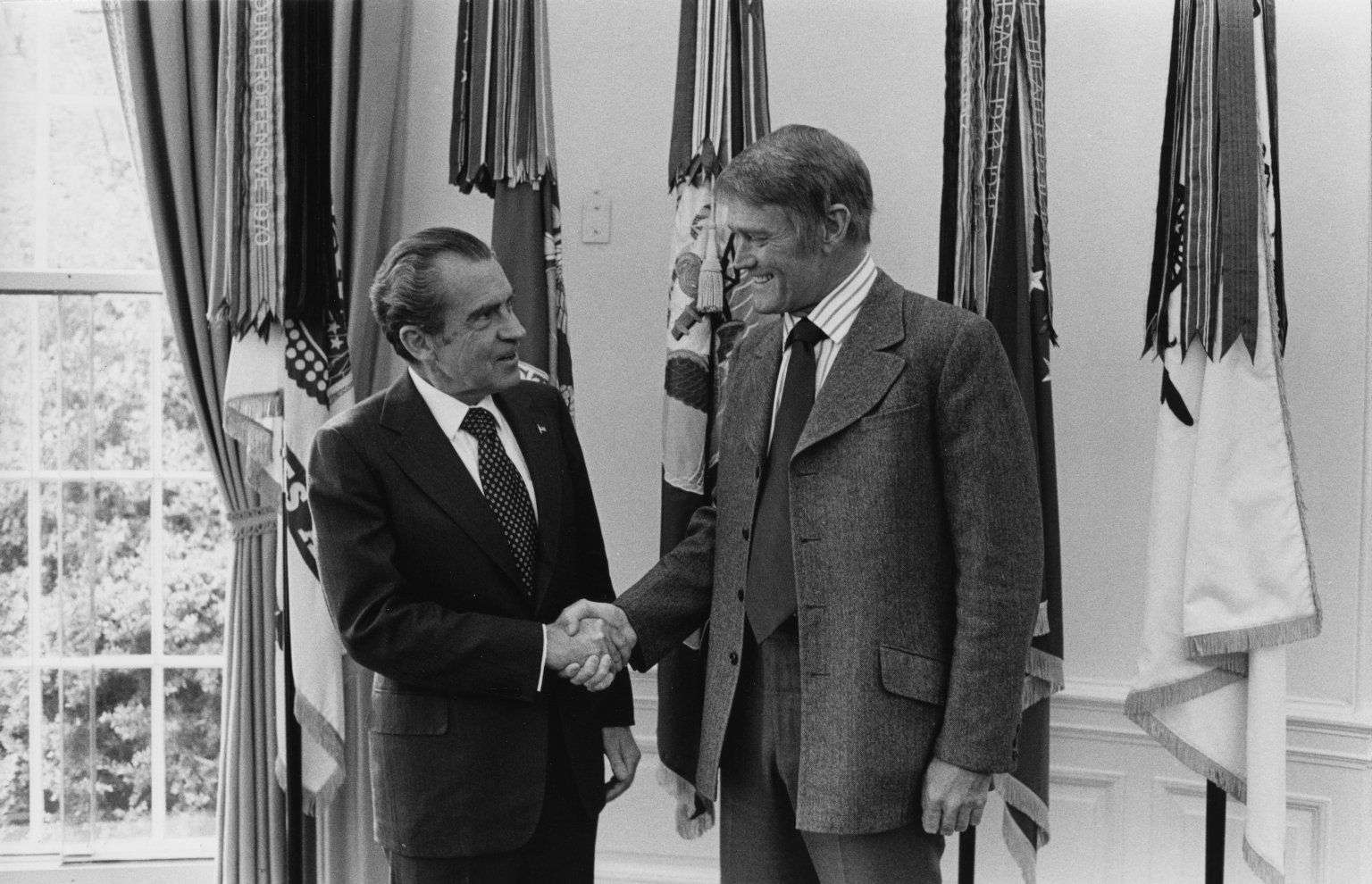Richard Nixon shakes hands with actor Chuck Connors (November 1973). Oliver F. Atkins photograph collection, Box 21, Folder 7. George Mason University. Libraries. Special Collections & Archives. Copyright not held by George Mason University Libraries. Restricted to personal, non-commercial use only. For permission to publish, contact Special Collections and Archives.