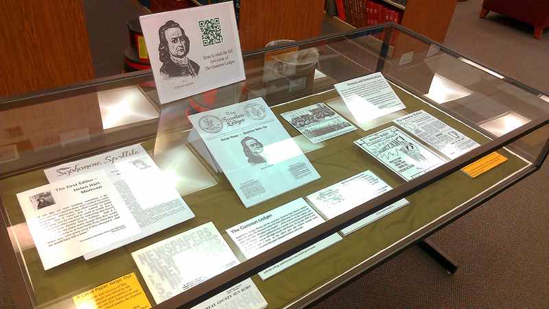 What's in a Name case featuring examples of The Gunston Ledger along with a brief history about how the paper started.