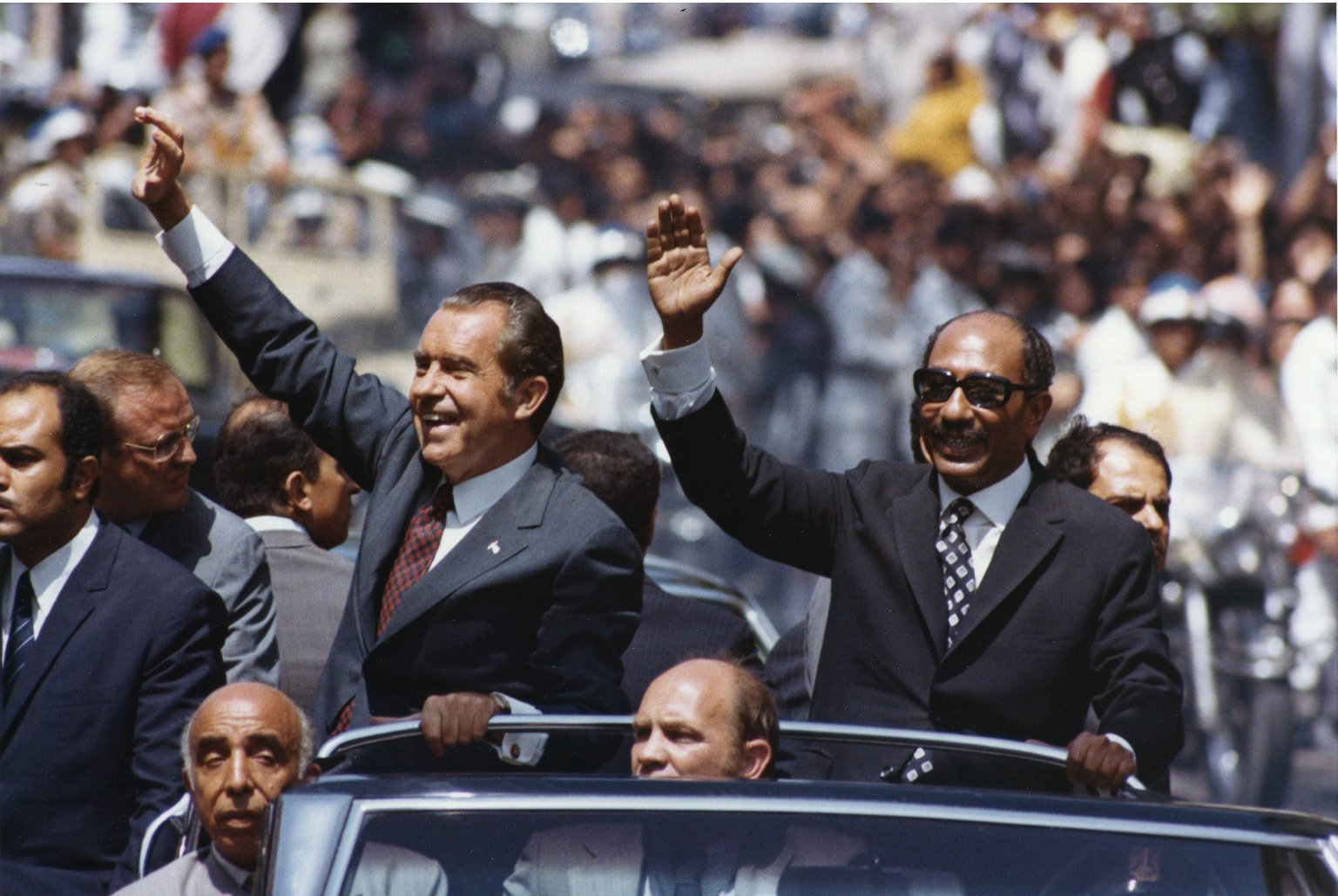 Anwar Sadat and Richard Nixon wave to crowds in Alexandria, Egypt (June 1974). Oliver F. Atkins photograph collection, Box 35, Folder 6. George Mason University. Libraries. Special Collections & Archives. Copyright not held by George Mason University Libraries. Restricted to personal, non-commercial use only. For permission to publish, contact Special Collections and Archives.