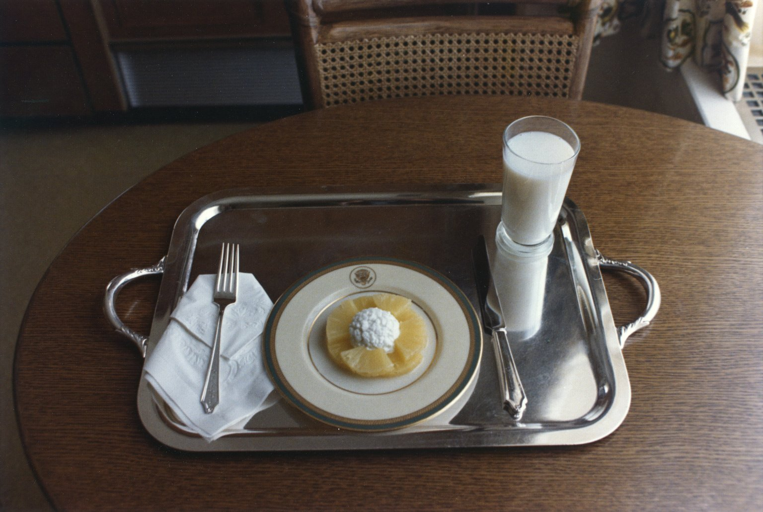 President Nixon's last meal in the White House: pineapple, cottage cheese and milk (August 9, 1974). Oliver F. Atkins photograph collection, Box 26, Folder 2. George Mason University. Libraries. Special Collections & Archives. Copyright not held by George Mason University Libraries. Restricted to personal, non-commercial use only. For permission to publish, contact Special Collections and Archives.